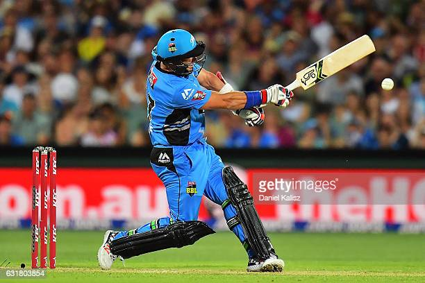 Brad Hodge of the Adelaide Strikers looses grip of his bat which struck Peter Nevill of the Melbourne Renegades during the Big Bash League match...