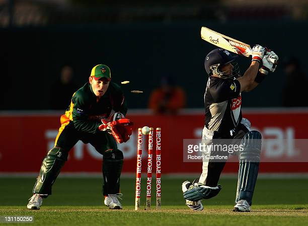 Brad Hodge of the Bushrangers is bowled by Xavier Doherty of the Tigers during the Ryobi One Day Cup match between the Tasmania Tigers and the...