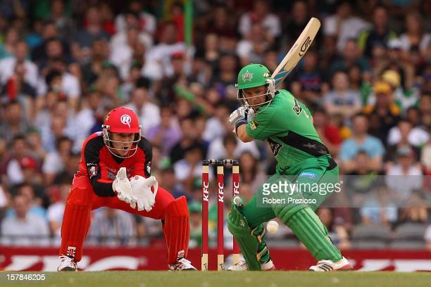 Brad Hodge of the stars plays a shot during the Big Bash League match between the Melbourne Renegades and the Melbourne Stars at Etihad Stadium on...
