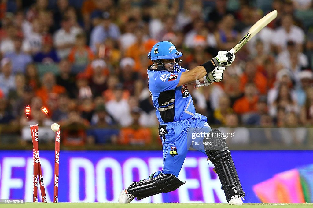Brad Hodge of the Strikers is bowled by Mitchell Johnson of the Scorchers during the Big Bash League between the Perth Scorchers and Adelaide Strikers at WACA on December 23, 2016 in Perth, Australia.