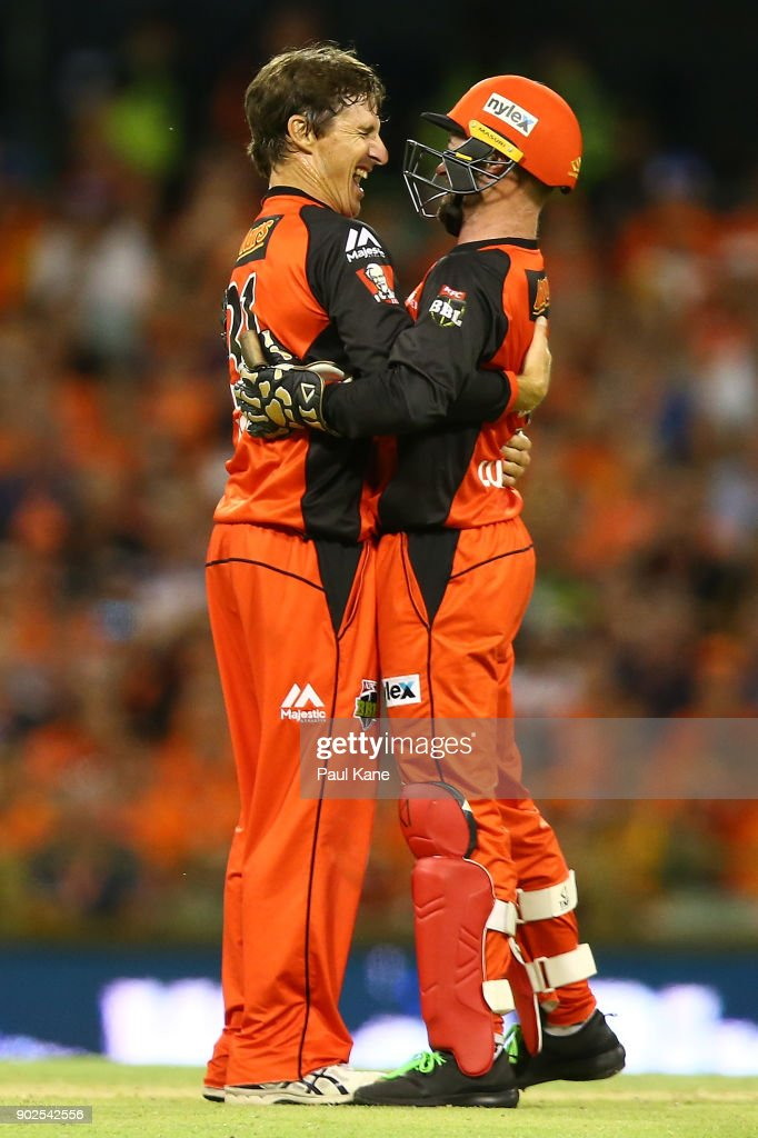 Brad Hogg and Tim Ludeman of the Renegades celebrate the wicket of Hilton Cartwright of the Scorchers during the Big Bash League match between the Perth Scorchers and the Melbourne Renegades at WACA on January 8, 2018 in Perth, Australia.
