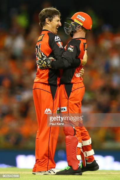 Brad Hogg and Tim Ludeman of the Renegades celebrate the wicket of Hilton Cartwright of the Scorchers during the Big Bash League match between the...