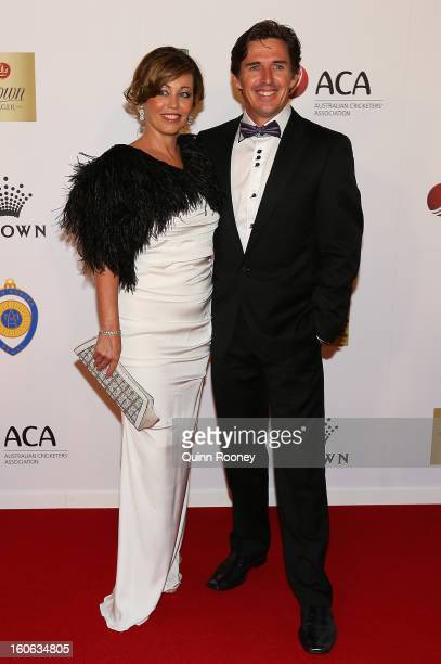 Brad Hogg of Australia and his partner Cheryl Bresland arrive at the 2013 Allan Border Medal awards ceremony at Crown Palladium on February 4 2013 in...