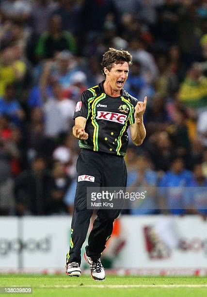 Brad Hogg of Australia celebrates after taking the wicket of Virat Kohli of India during the International Twenty20 match between Australia and India...