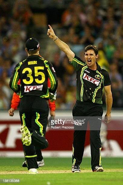 Brad Hogg of Australia celebrates the wicket of Virender Sehwag of India during the International Twenty20 match between Australia and India at...