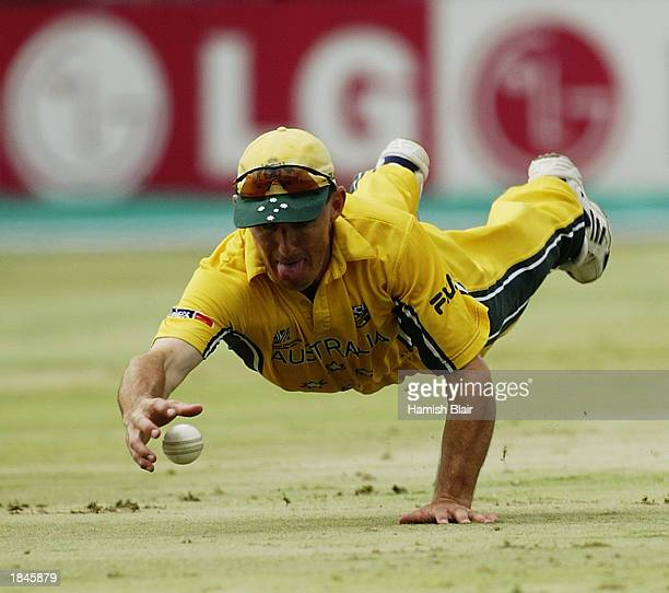 Brad Hogg of Australia dives to field during the ICC World Cup One Day International Pool A match between Australia and England held on March 2, 2003...
