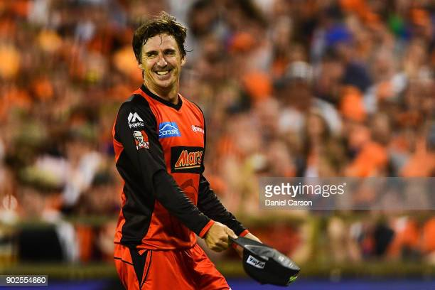 Brad Hogg of the Melbourne Renegades reactes to the crowsd after dropping a catch during the Big Bash League match between the Perth Scorchers and...