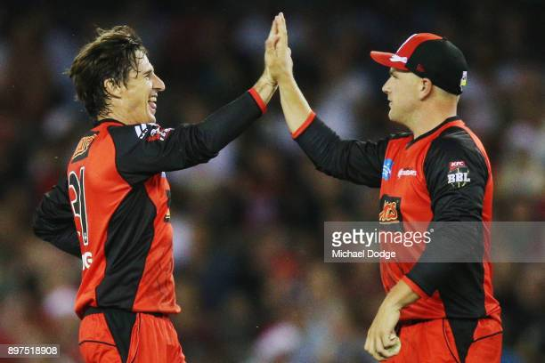 Brad Hogg of the Renegades celebrates a wicket with Aaron Finch during the Big Bash League match between the Melbourne Renegades and the Brisbane...