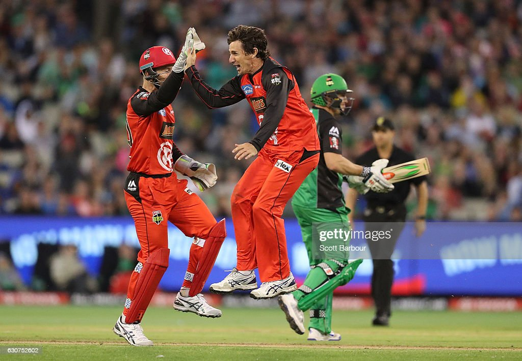 Brad Hogg of the Renegades is congratulated by his teammates after dismissing David Hussey of the Stars during the Big Bash League match between the Melbourne Stars and Melbourne Renegades at Melbourne Cricket Ground on January 1, 2017 in Melbourne, Australia.