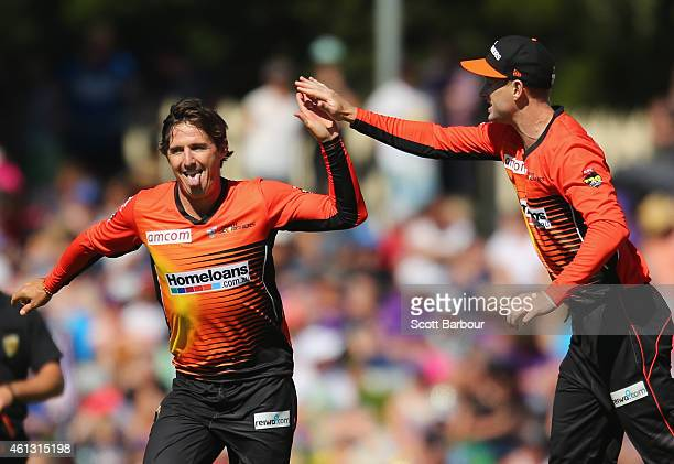 Brad Hogg of the Scorchers celebrates with his teammates after dismissing George Bailey of the Hurricanes during the Big Bash League match between...
