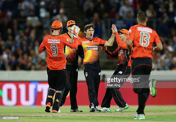 Brad Hogg of the Scorchers celebrates with teammates after taking the wicket of Jordan Silk of the Sixers during the Big Bash League final match...