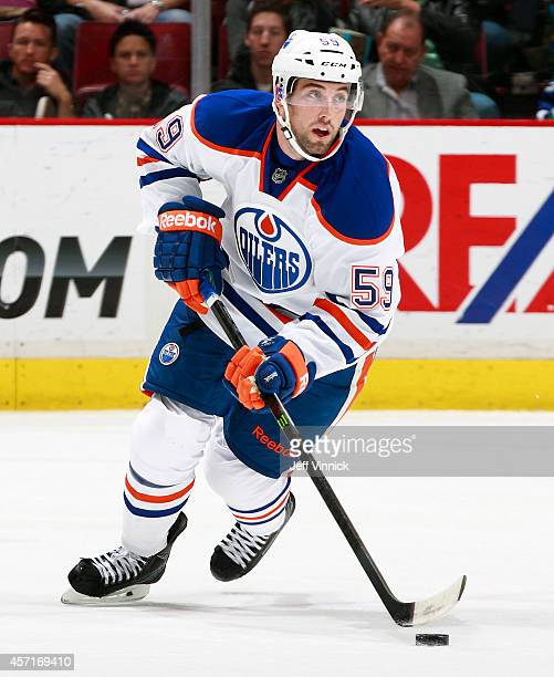 Brad Hunt of the Edmonton Oilers skates up ice with the puck during their NHL game against the Vancouver Canucks at Rogers Arena October 11, 2014 in...