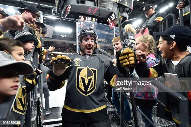 Brad Hunt of the Vegas Golden Knights is greeted by fans as he walks to the locker room prior to the game against the Ottawa Senators at TMobile...