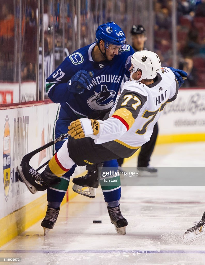 Brad Hunt #77 of the Vegas Golden Knights is sent flying after getting hit by Cole Cassels #52 of the Vancouver Canucks in NHL pre-season action on September 17, 2017 at Rogers Arena in Vancouver, British Columbia, Canada.
