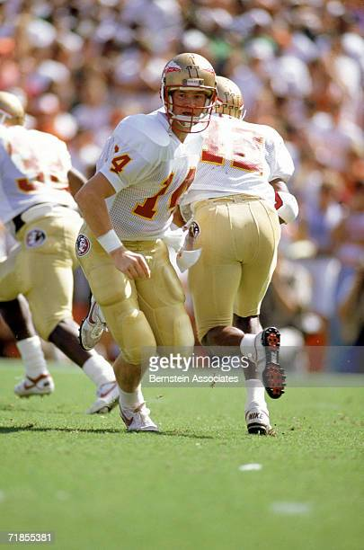 Brad Johnson of the Florida State Seminoles hands-off the football in October 1990.