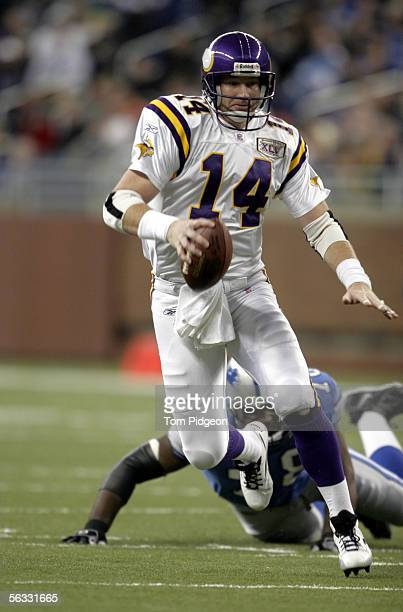Brad Johnson of the Minnesota Vikings scrambles for yards against the Detroit Lions during the game at Ford Field on December 4, 2005 in Detroit,...