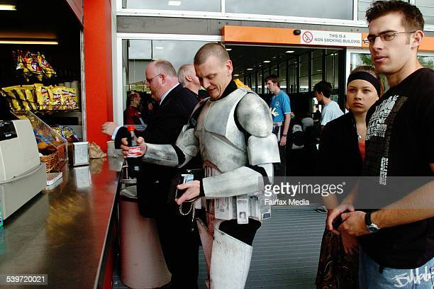Brad Jones dressed as a Clone Trooper buys his lunch the Supanova Pop Culture Expo in Walsh Bay 14 October 2005 SHD NEWS Picture by JANIE BARRETT