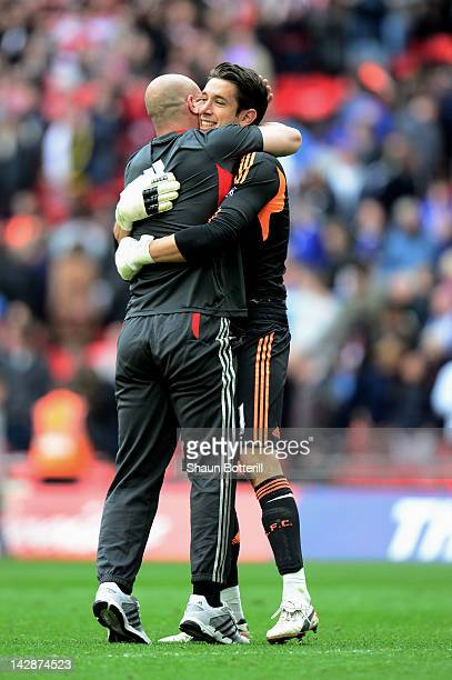 Brad Jones of Liverpool celebrates with fellow goalkeeper Pepe Reina after the FA Cup with Budweiser Semi Final match between Liverpool and Everton...
