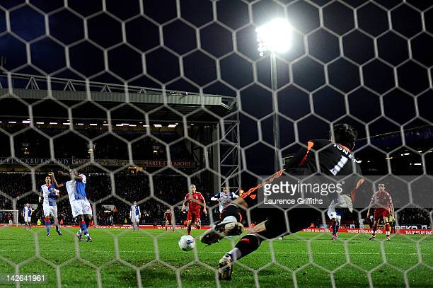 Brad Jones of Liverpool saves the penalty kick of Yakubu of Blackburn Rovers during the Barclays Premier League match between Blackburn Rovers and...