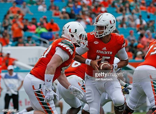 Brad Kaaya fakes the handoff to Gage Batten of the Miami Hurricanes in the end zone against the Georgia Tech Yellow Jackets on November 21 2015 at...