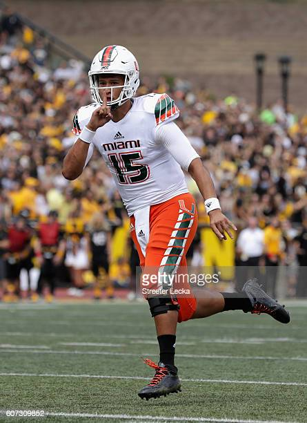 Brad Kaaya of the Miami Hurricanes celebrates after a touchdown against the Appalachian State Mountaineers during their game at Kidd Brewer Stadium...