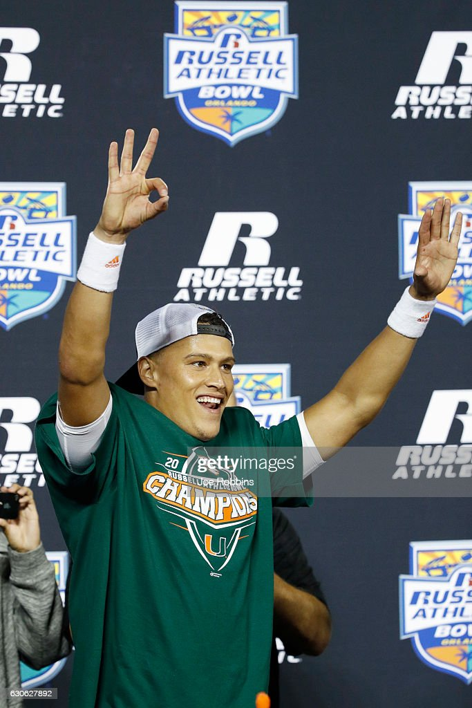 Brad Kaaya #15 of the Miami Hurricanes reacts after being named MVP following the Russell Athletic Bowl against the West Virginia Mountaineers at Camping World Stadium on December 28, 2016 in Orlando, Florida. Miami defeated West Virginia 31-14.