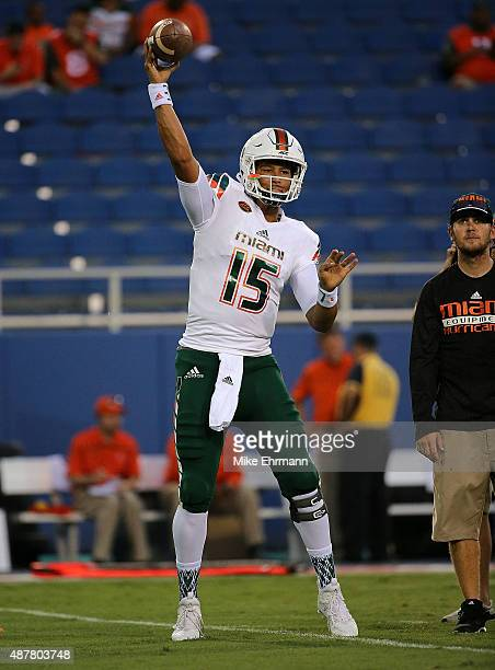 Brad Kaaya of the Miami Hurricanes warms up during the a game against the Florida Atlantic Owls at FAU Stadium on September 11 2015 in Boca Raton...