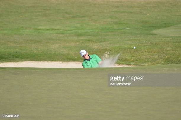 Brad Kennedy of Australia plays a bunker shot during day one of the New Zealand Open at The Hills on March 9 2017 in Queenstown New Zealand