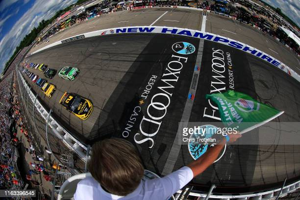Brad Keselowski driver of the Alliance Truck Parts Ford and Kyle Busch driver of the Interstate Batteries Toyota lead the field to the green flag to...