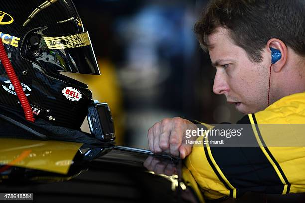 Brad Keselowski driver of the Alliance Truck Parts Ford stands in the garage area during practice for the NASCAR Sprint Cup Series Toyota/Save Mart...