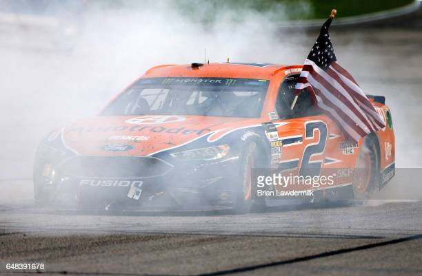 Brad Keselowski driver of the Autotrader Ford celebrates with a burnout after winning the Monster Energy NASCAR Cup Series Folds Of Honor QuikTrip...
