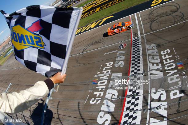 Brad Keselowski driver of the Autotrader Ford crosses the finish line to win the Monster Energy NASCAR Cup Series SouthPoint 400 at Las Vegas Motor...