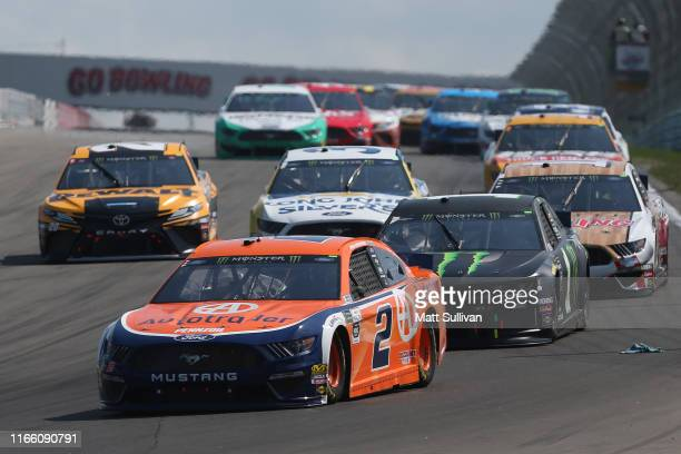 Brad Keselowski, driver of the Autotrader Ford, leads a pack of cars during the Monster Energy NASCAR Cup Series Go Bowling at The Glen at Watkins...