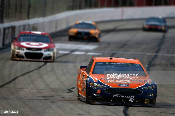 Brad Keselowski driver of the Autotrader Ford leads Kyle Larson driver of the Target Chevrolet during the Monster Energy NASCAR Cup Series Folds Of...