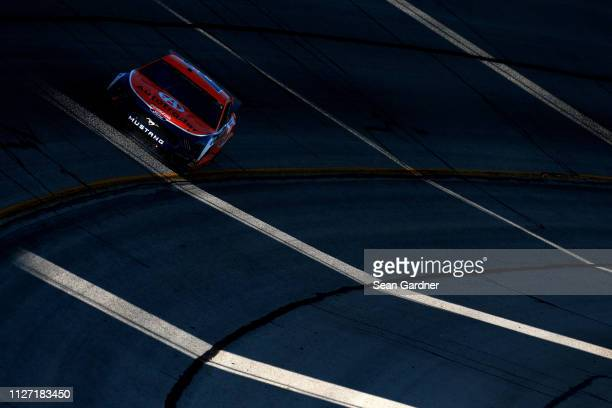 Brad Keselowski driver of the Autotrader Ford races during the Monster Energy NASCAR Cup Series Folds of Honor QuikTrip 500 at Atlanta Motor Speedway...