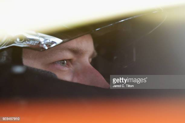 Brad Keselowski driver of the Autotrader Ford sits in his car during practice for the Monster Energy NASCAR Cup Series Folds of Honor QuikTrip 500 at...