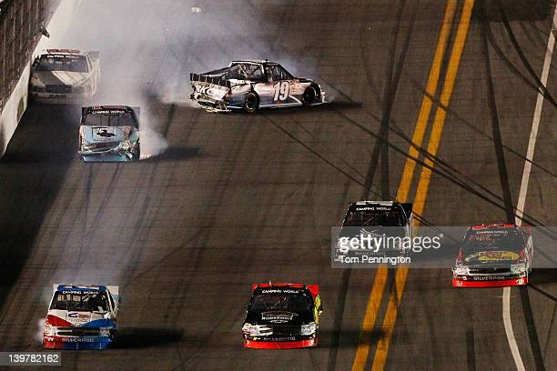 Brad Keselowski driver of the Brad Keselowski Racing Dodge spins during the NASCAR Camping World Truck Series NextEra Energy Resources 250 at Daytona...