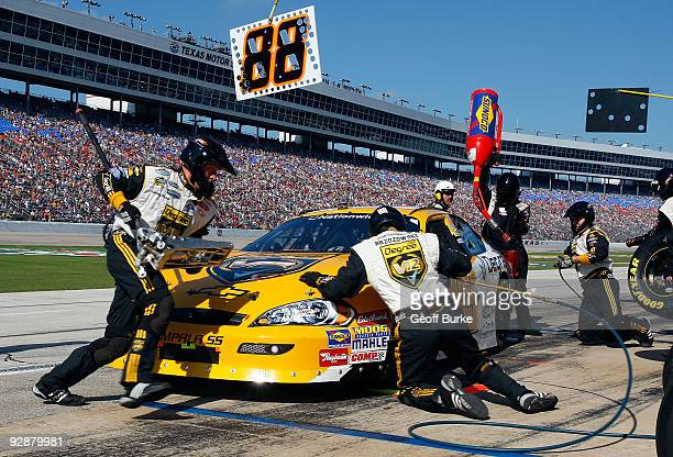 Brad Keselowski driver of the Degree V12 Chevrolet pits during the NASCAR Nationwide Series O'Reilly Challenge at Texas Motor Speedway on November 7...
