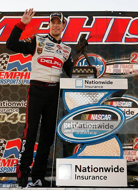 Brad Keselowski driver of the Delphi Chevrolet poses with the winniner trophy after winning the NASCAR Nationwide series Kroger 'On Track For Cure'...