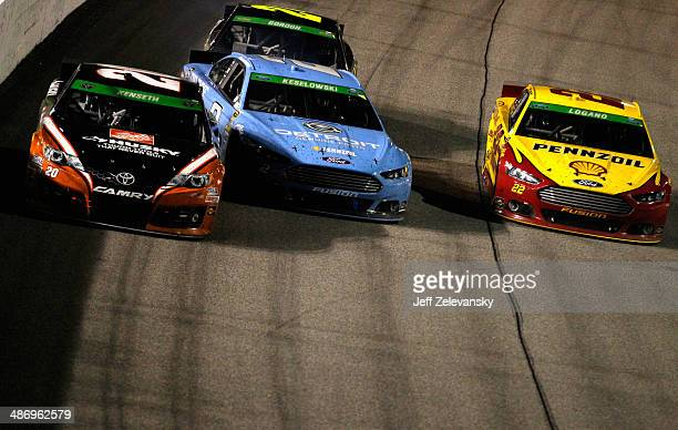 Brad Keselowski driver of the Detroit Genuine parts Ford bumps Matt Kenseth driver of the Home Depot Husky Toyota as Joey Logano driver of the...