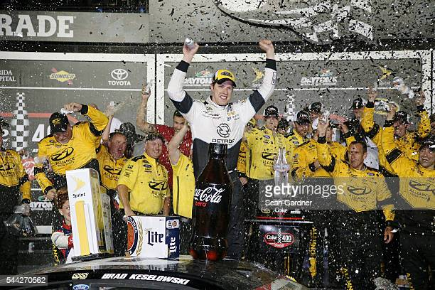 Brad Keselowski driver of the Detroit Genuine Parts Ford celebrates in Victory Lane after winning the NASCAR Sprint Cup Series Coke Zero 400 Powered...
