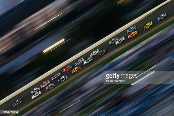 Brad Keselowski driver of the Detroit Genuine Parts Ford leads a pack of cars during the Monster Energy NASCAR Cup Series 59th Annual Coke Zero 400...