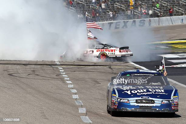 Brad Keselowski driver of the Discount Tire Dodge celebrates winning the Nationwide championship with a thirdplace finish in the NASCAR Nationwide...