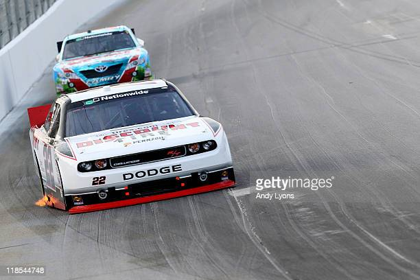 Brad Keselowski driver of the Discount Tire Dodge leads Joey Logano driver of the GameStop Toyota during the NASCAR Nationwide Series Feed the...