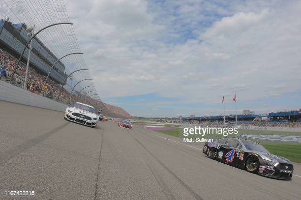 Brad Keselowski, driver of the Discount Tire Ford, and Kevin Harvick, driver of the Mobil 1 Ford, lead the field during a pace lap for the Monster...