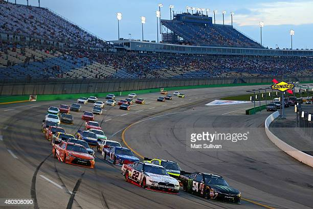 Brad Keselowski, driver of the Discount Tire Ford, and Kyle Busch, driver of the Monster Energy Toyota, lead the field at a restart during the NASCAR...