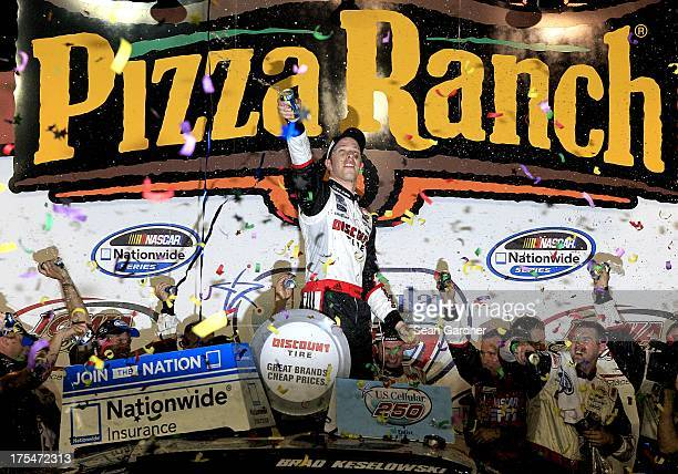 Brad Keselowski driver of the Discount Tire Ford celebrates after winning the NASCAR Nationwide Series US Cellular 250 Presented by Enlist Weed...