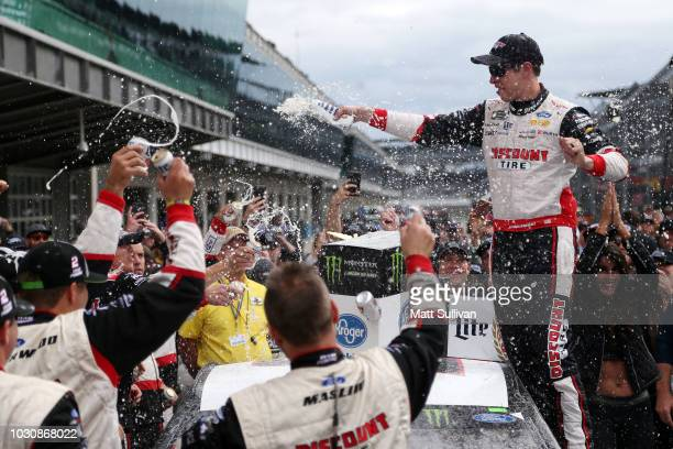 Brad Keselowski driver of the Discount Tire Ford celebrates in victory lane after winning the Monster Energy NASCAR Cup Series Big Machine Vodka 400...