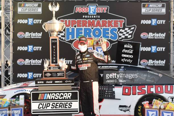 Brad Keselowski, driver of the Discount Tire Ford, celebrates in Victory Lane after winning the NASCAR Cup Series Food City presents the Supermarket...