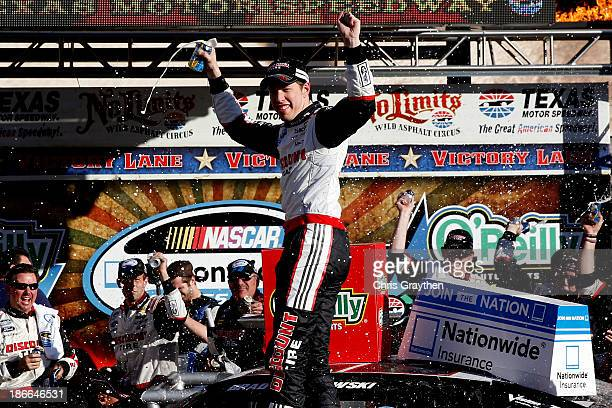 Brad Keselowski driver of the Discount Tire Ford celebrates in victory lane after winning the NASCAR Nationwide Series O'Reilly Auto Parts 300 at...